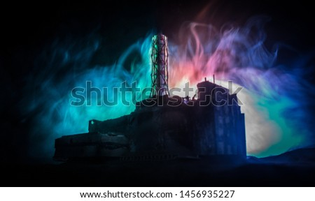 Creative artwork decoration. Chernobyl nuclear power plant at night. Layout of abandoned Chernobyl station after nuclear reactor explosion. Selective focus #1456935227