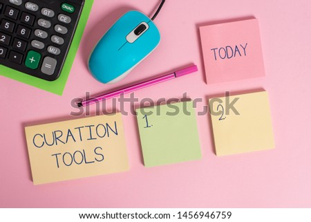 Word writing text Curation Tools. Business concept for Software used in gathering information relevant to a topic Blank notepads wire mouse calculator sheet marker pen colored background.