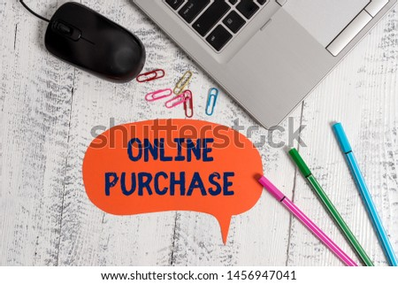 Text sign showing Online Purchase. Conceptual photo Purchases electronic commerce goods from over the Internet Metallic slim laptop speech bubble colored clips pens mouse wooden vintage. #1456947041
