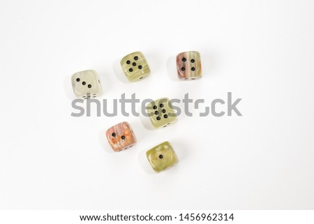 Dices made of natural stone on a white background. Copy space. Gaming.  #1456962314