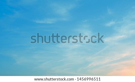 Beautiful blue pastel sky with clouds background.Sky clouds.Sky with clouds weather nature cloud blue.Blue sky with clouds and sun. #1456996511