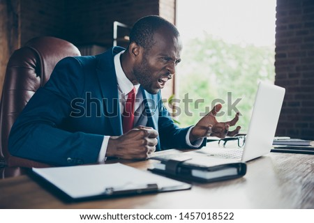 Photo of dark skin guy express anger in skype communication wear elegant costume sitting office chair #1457018522