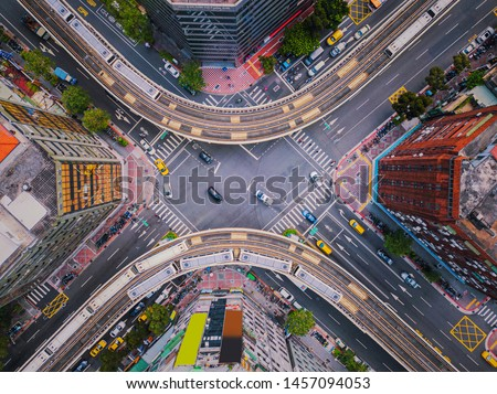 Aerial view of cars and trains with intersection or junction with traffic, Taipei Downtown, Taiwan. Financial district and business area. Smart urban city technology. Royalty-Free Stock Photo #1457094053
