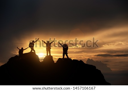 Silhouette of celebrating life, Hikers climbing up mountain cliff. Climbing group helping each other while climbing up in sunset. Concept of help and teamwork, Limits of life and Hiking su #1457106167