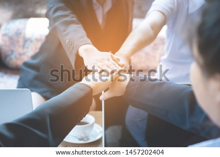 Close up of young asian business woman putting their hands together. Unity and teamwork concept,process in vintage style. #1457202404