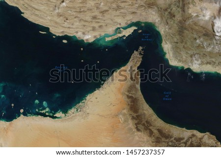 Strait of Hormuz, a strait between the Persian Gulf and the Gulf of Oman, seen from space - Elements of this image furnished by NASA #1457237357