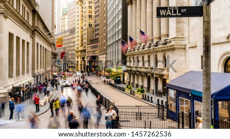 Manhattan, New York. USA Famous Wall street and the building in New York Stock Exchange with patriot flag.