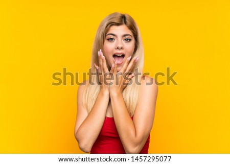 Teenager girl over isolated yellow background with surprise facial expression #1457295077