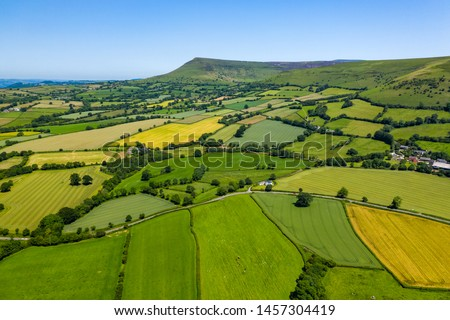 Aerial view of green fields and farmlands in rural Wales #1457304419