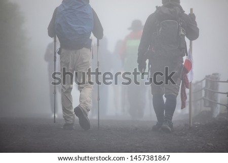 Hikers are walking on Yoshida trail in mist toward the peak of Fuji Mountain, Japan #1457381867
