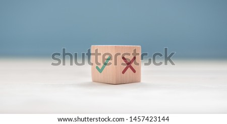 True and false symbols accept rejected for evaluation, Yes or No on wood blogs on blue background. #1457423144