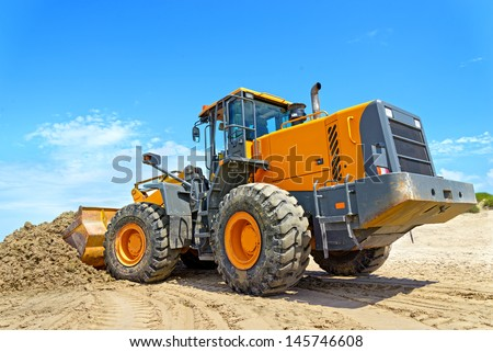 The bulldozer cleans dirt on a beach after a storm #145746608
