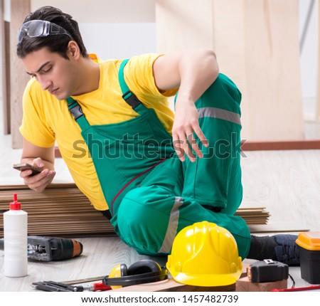 Contractor working on laminate wooden floor #1457482739