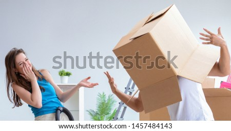 Young family unpacking at new house with boxes #1457484143