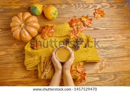 Autumn Flat Lay. Pumpkin,coffee, fall leaves. Nuts,acorns on rustic blanket and wood background top view. Seasons greetings. #1457529470