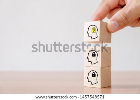 Business concept of creative idea and innovation. Hand picked wooden cube block with unlock icon (new idea) and head human symbol have lock idea. #1457548571