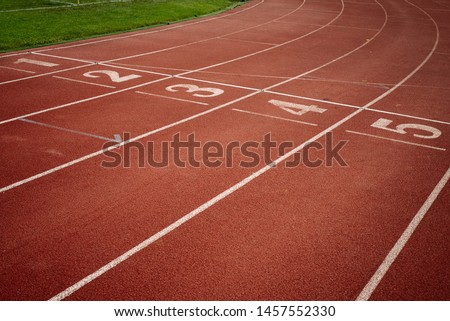 Sport. A red treadmill or athletics track at the stadium. Copy space #1457552330
