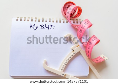 Body mass index BMI. Body mass index formula rate in a notepad. Concept BMI body mass index formula rate formula, fitness and weight loss. Note written: BMI (body mass index) formula, health concept #1457571101