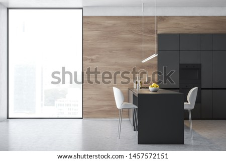 Side view of loft kitchen interior with wooden walls, concrete floor, gray cupboards with two ovens and grey island with cooker, sink and two stools. 3d rendering #1457572151
