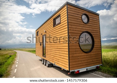 Mobile tiny house. Great for outdoor experiences and wildlife. Lots of mobility and pure adventure. No need for special authorizations, only a decent car to pull this tiny house and off you go. Royalty-Free Stock Photo #1457579306