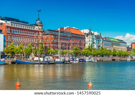 Beautiful cityscape of Helsinki with the traditional architecture, wharf with boats and clear blue sky on the background, Finland #1457590025