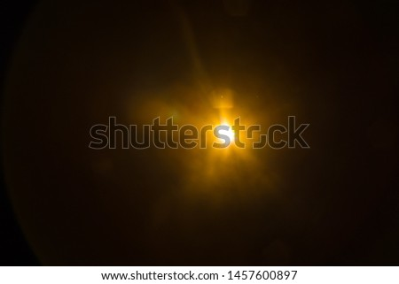 Abstract Natural Sun flare on the black #1457600897