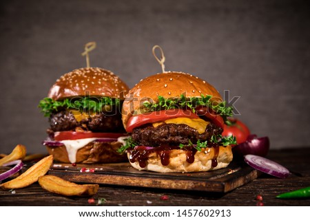 Close-up of home made tasty burgers on wooden table. #1457602913