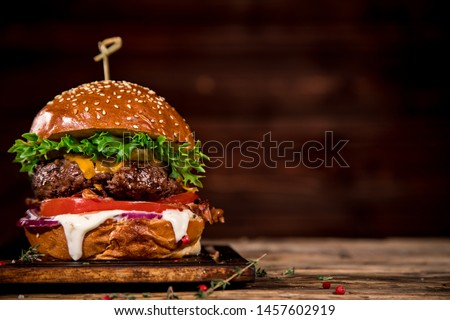 Close-up of home made tasty burger on wooden table. #1457602919