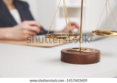 Picture of libra on the table isolated.