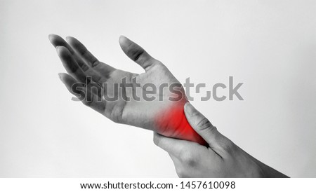 Hand anatomy with red highlight on wrist pain. Wrist pain may cause from muscle strain, tendinitis, ligament sprain, arthritis, nerve entrapment or bone fracture form trauma injury. Medical symptom #1457610098