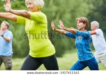 Seniors do Qi Gong or Tai Chi exercise for relaxation and health #1457611163