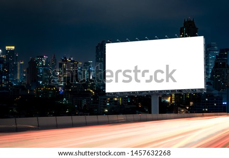 Billboard mockup outdoors, Outdoor advertising poster at night time with street light line for advertisement street city night. With clipping path on screen. #1457632268