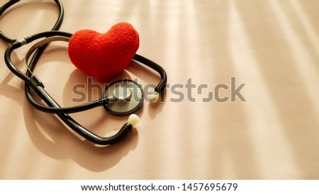 Stethoscope and red heart on natural light sources background, top view. Healthcare and medical concept. #1457695679