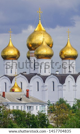 Assumption cathedral golden domes, with green trees and grey clouds background, Yaroslavl, Russia #1457704835