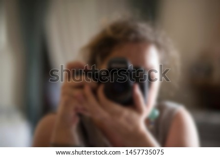 photographer with camera. Woman taking photos #1457735075