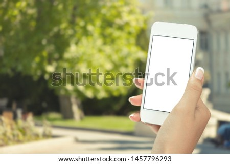 Male hand holding blank smart phone isolated on white background with clipping path for the screen #1457796293