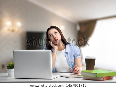 Business woman work process concept. Young woman working university project with generic design laptop. Blurred background, film effect. #1457801918