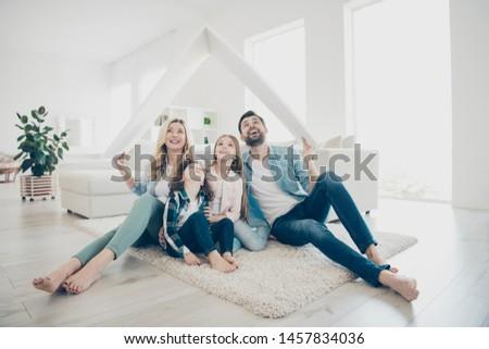 Photo of young family adopted two children move new apartments hold hands paper roof hoping best future #1457834036