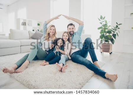 Photo of four people foster family moving new apartments making arms roof promise lovely children protection #1457834060