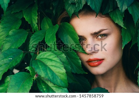 Charming woman makeup red lips green leaves Exotic tropics model #1457858759