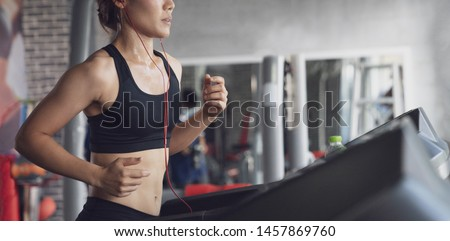 People running in machine treadmill at fitness gym, Young woman workout in gym healthy lifestyle, Young people running on a treadmill in health club #1457869760