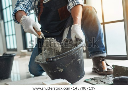Construction technicians working with cement paving, cement mix with the trowel at the side work, Construction side work #1457887139