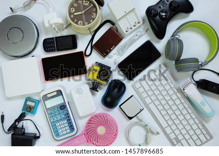 many used modern Electronic gadgets for daily use on White floor, Reuse and Recycle concept, Top view. #1457896685