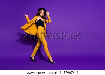 Profile side full length body size view of nice-looking gorgeous attractive content cheerful cheery wavy-haired lady motion touching hat isolated over bright vivid shine violet lilac background #1457907644