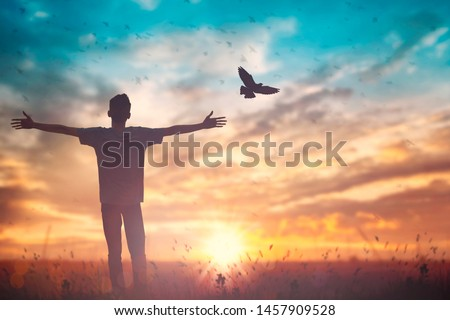 Happy man rise hand on morning view. Christian inspire praise God on good friday background. Male self confidence empowerment on mission arm courage nature the sun concept strength wisdom #1457909528