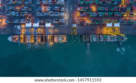 Container ship carrying container at night for import and export, business logistic and transportation by container ship in open sea, Aerial view industrial crane cargo freight container ship. #1457911592