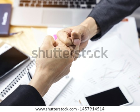Businessman of a fist bump,which Businessmen trust commitment as support which Business Partners holding hands relationship marketing for reach successful achievement and meeting commit concept #1457914514