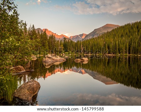 Sunset reflection of mountains and rocks at Bear Lake in Rocky Mountain National Park, Colorado #145799588
