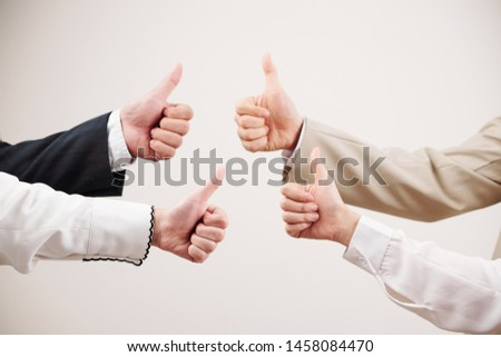 Close-up of business team showing thumbs up and symbolize success in business against the white background #1458084470