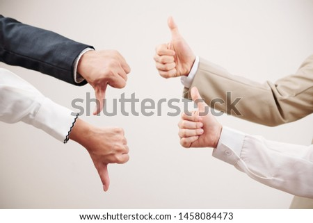 Group of two business partners showing thumb up and other two partners showing failure in business isolated on white background #1458084473